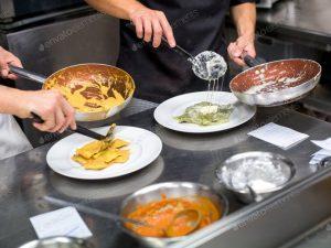 Chefs+serving+ravioli+pasta